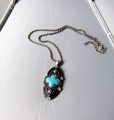 NECKLACE / CHOKER  : Gothic Fancy Blue Cross Or Sky Blue Leaf Pendant Accented with Swarovski Crystals on a Rope - Cable  Chain. $29.00, via Etsy.