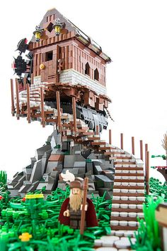 A lego house on a pile of rocks, with winding staircase. How can it balance?