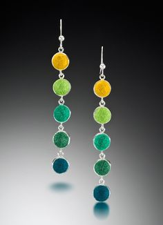 Cara Romano; silver and felting jewelry... One of our most popular earring designs, fun to wear light weight studies in color hues.