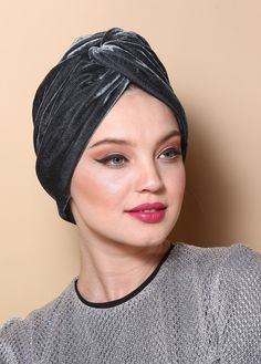 V-front turban made of silvery gray velvet. The turban is stretchy, light, and easy to wear! No tying involved, this turban is worn like a hat. Can be worn as a full or half head covering- tuck your hair in or leave it out!
