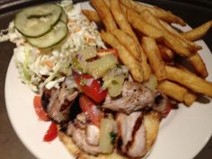 Marinated Chipolte pork sliced thin served with pineapple salsa,crunchy coleslaw and Vanessa's homemade pickles on a toasted La Strada bun!
