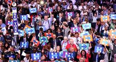 Delegates hold up signs in support of Hillary Clinton. (Getty)