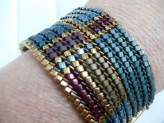 USA made ndebele stitch woven cuff bracelet triangular beads gold tone