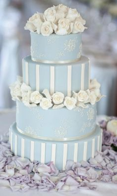 Romantic floral tier wedding cake with metallic stencil design | Nikki Leigh McKean Photography | See more of this romantic lilac wedding - http://www.todaysbride.ca/articles/victoria-stockford-lehman-adam-gordon