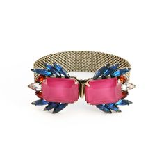 he Leda bracelet is our new go-to bracelet for cocktailing! In drop dead pink and navy hues, the clever clasp features 2 clusters of vintage blue and topaz navettes (circa 1950), hand-colored glass stones, and Austrian crystal accents. Brass chain with box and tongue clasp.