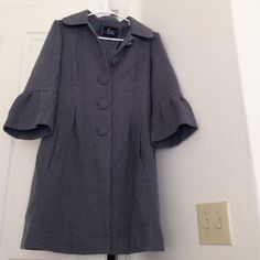 Grey/metallic 3/4 length sleeve jacket Awesome fabric with silver threading running through the grey. 3/4 length sleeve and darling buttons. Great, classic statement piece! BB Dakota Jackets & Coats