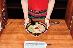 """With its """"flavor concentration booths,"""" the Japanese chain takes solo dining to the extreme."""