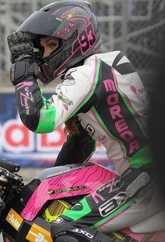 Shelina Moreda peeking out of her helmet on track for Team Brammo!