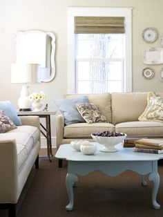 A painted coffee table pops against neutral walls and furnishings.