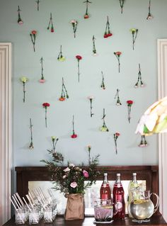 Fresh Flower Wall - simply use washi tape to secure carnation / other sturdy flower stems to the wall in varied pattern
