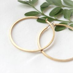 ★★Description★★    These earrings are super simple and sleek gold hoop earrings. So chic and simple youll want to wear it everyday!    Size:This earring