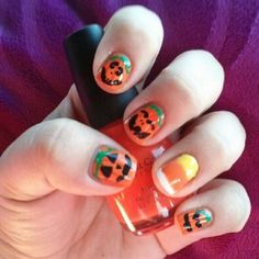 Sinful Colors Big Daddy. Adorable jack-o-lantern nail art with candy corn accent nail.