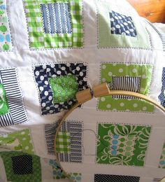 green and navy blue crib quilt for the nursery.