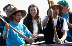 Kate Middleton Photos Photos - Catherine, Duchess of Cambridge waves from a traditional canoe as she arrives at Skidegate Heritage Centre and Princess Charlotte are visiting Canada as part of an eight day visit to the country taking in areas such as Bella Bella, Whitehorse and Kelowna - 2016 Royal Tour to Canada of the Duke and Duchess of Cambridge - Haida Gwaii, British Columbia