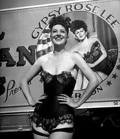 Vintage candid photo features Gypsy posing in front of a trailer from her 1949 'Royal American Shows' travelling tent show.. 'Royal American' was one of the longest-running Carnival circuit burlesque shows..