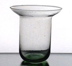 Hanging Candle Holder Flared Rim 4 3/8 x 4.5 Light Green Glass    Replacement glass candle holder, shaped to fit into chandeliers or other metal type ringed holders for candles. Pale Green Color. Hand blown, and flared at the rim. Generic holder, Suitable for votives or tealights.  Rounded bottom. 4 3/8  inches across the top rim, and 4.5 inches tall.   Fits in rings that measure 3.75 inches to 4 inches.