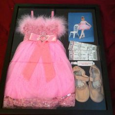 Shadow boxed first dance costume, ballet shoes, dance picture, recital tickets, and recital bracelet. :)