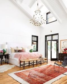 Summer style!! Modern contemporary Bohemian Chic style bedroom! LOOK at the ceiling details!! So tall, fresh and light! Pink and coral details in bedroom