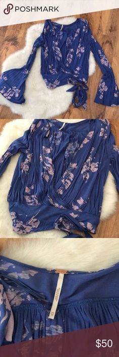 Free People Blue Floral crop top extra small This top is so gorgeous and looks great with cut off jean shorts. Long bell sleeves. Size extra small. Only worn a handful of times, in great shape Free People Tops Crop Tops