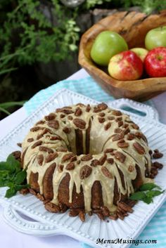 Apple Praline Bundt Cake - Moist tender spiced cake, juicy and slightly sweet/tart apples, creamy praline glaze, and those candied glazed pecans?  All you need now is a good cup of coffee and you are set!  Step-by-step photo recipe tutorial as well as full length video!