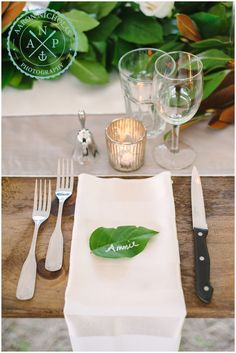 I love this simple wedding reception decor - white roses, white candles, loads of greenery and creative name cards made with leaves and a paint pen!  // Photo by Charleston , SC Wedding Photographers Aaron and Jillian Photography