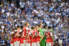 The Arsenal team stand together in support of those who lost their lives in the Manchester Terror attack prior to the Emirates FA Cup Final between Arsenal and Chelsea at Wembley Stadium on May 27, 2017 in London, England.