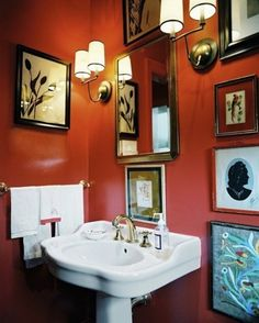 Small Bathroom Design Photo - A white pedestal sink and framed art in a bathroom with red walls and a pair of sconces Bathroom Red, Bathroom Photos, Bathroom Colors, Bathroom Interior, Small Bathroom, Bathroom Ideas, Downstairs Bathroom, Bathroom Gallery, Colorful Bathroom