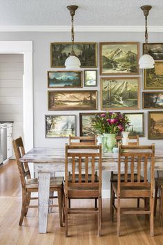 Old landscape paintings make for appealing, earthy decor in this Oregon dinning room.