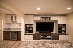 Choose a custom built-in entertainment center from California Closets and transform your living room. Learn more about our wall media centers and TV units. Media Room Design, Wall Design, California Closets, Media Wall, Custom Cabinetry, Media Center, Tv Unit, Room Organization, Entertainment Center