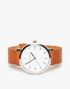 A simple and clean, oversized wrist watch from The Horse with a large polished stainless steel case, white face and premium tan leather band.   	•	Minimal, oversized wristwatch  •	Genune Italian leather details and lining 	•	Japanese Quartz movement