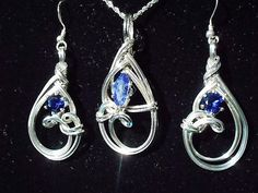 this one of a kind set is made of Argentium silver and three lab sapphires. the pendant is a petite 3/4 of an inch wide and 1-5/8 inches long with a 14mm x 7mm lab sapphire marquee and the earrings are 5/8 of an inch wide and 2 inches in total length with 6mm round lab sapphires . these are not imitation sapphires, they are chemically identical to natural earth mined sapphire. Yet the Earth did not have to be destroyed to get them.    I use Argentium silver in all of my silver work…
