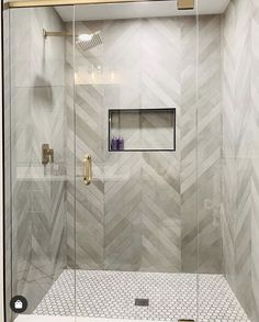 We can't get enough of this amazing shower by The bathroom walls covered in Mate Chevron Chevron Bathroom, Grey Bathroom Tiles, Bathroom Tile Designs, Bathroom Interior Design, Bathroom Wall, Modern Bathroom, Chevron Walls, Chevron Tile, Wall Tiles