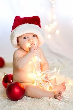 I've seen this type of photo all over Pinterest and I'm just going to go ahead and say it... Babies + Christmas lights is cute but PLEASE DON'T LET THE BABY CHEW ON THE PLUGGED IN CHRISTMAS LIGHTS, PEOPLE!! SAFETY FIRST!