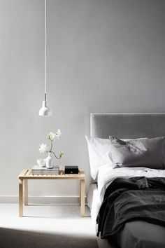 white, grey and tan bedroom, with natural fabrics and soft grey walls - Lovely Home in Grey