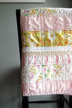 Vintage sheets baby quilt - love the vertical quilting on the horizontal fabric stripes