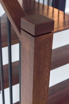 This design was created with the Aalto series plain bar (16.2.1) and the single rectangular balusters (16.6.3). These components are made of hollow wrought iron, and are available in a Satin Black (shown) or Ash Grey powder-coated finish. Our wrought iron pairs seamlessly with the 4000 series dark wood newel post, and the square newel cap. We offer parts, install services, and custom components throughout Texas. Click the image for more information.