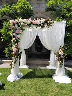 Shades of blushes, pinks and ivory for this Chuppah/Arch wedding ceremony set up