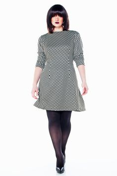 JIBRI plus sized shift dress with boat neck and chic side pockets. Long fitted sleeves. Back zipper Trendy but also a dress that will never go out of