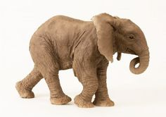 #Ceramic #sculpture by #sculptor Lesley Prickett titled: 'Young African Elephant (Small Elephant Calf statue)'. #LesleyPrickett
