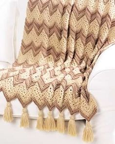 This ripple afghan pattern calls for elegant beige colors and fancy tassels. This ripple afghan is worked in single crochet for a sturdy and warm cover. This crochet ripple afghan pattern from Crochet Afghans, Crochet Ripple Afghan, Free Crochet, Baby Afghans, Crochet Blankets, Chevron Afghan, Afghan Crochet Patterns, Knitting Patterns, Free Knitting