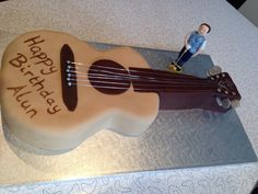A fantastic cake made by our supplier Sister Cakes. The cake was for a surprise 40th birthday party for Alun Hopkins. His celebration was in Shampan Bromley. As he plays the guitar and is a keen golfer, Sister Cakes created the perfect cake.  For all cake enquiries please contact Samantha - 07805 393407 or Tanya - 07906 813074 40th Birthday Parties, Happy Birthday, How To Make Cake, Plays, Celebration, Guitar, Cakes, Drink, Party