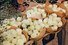 white roses wrapped with brown paper