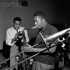 "CLICK PHOTO TO HEAR ""LOCOMOTION.""  15 Sep 1957, Hackensack, New Jersey, USA --- Trumpeter Lee Morgan accompanies saxophonist John Coltrane during the recording session for Coltrane's Blue Train album. In the foreground is Curtis Fuller's trombone. --- Image by © Mosaic Images/CORBIS © Corbis. All Rights Reserved. —"