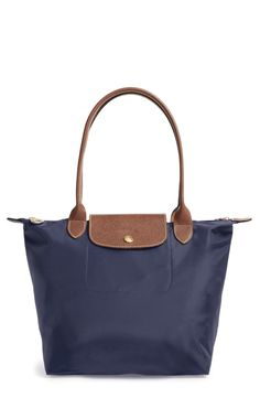 Embossed leather trim complements the sleek nylon of a must-have tote featuring a water-resistant lining and a fold-flat design for compact storage. Style Name:Longchamp Small Le Pliage Nylon Shoulder Tote. Style Number: Available in stores. Nylon Tote, Longchamp, Women's Accessories, Nordstrom, Tote Bag, Purses, Leather, Flat Design, Compact