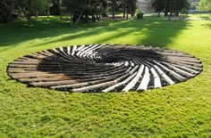 """Chris Drury's """"Carbon Sink"""" is made from pine logs & coal (both of which were once living trees and died during times of atmospheric warming)"""
