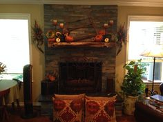 Fall mantel.  Pretty pillows on stained concrete floor.  By Cindy Raymond.