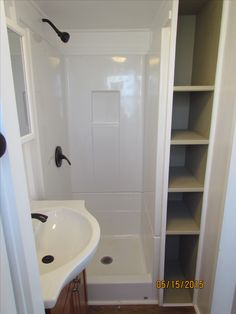 Something to think about for that awkward space behind the tub/shower add door that opens away from wall and has hinges that allow it to fully open. probably not good to have it as deep as the shower that might be too much.)