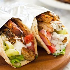 Make Avengers Shawarma! A simple chicken shawarma recipe with tender, smokey chicken and a garlic yogurt sauce served over crisp veggies and pita bread.