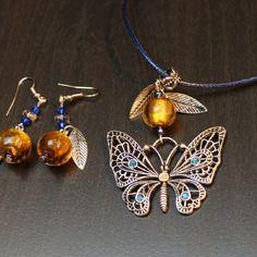 Parure vintage fantaisie avec papillon et perle