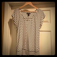 ✨White House Black Market✨ This adorable black and white shirt couldn't be cuter.  ✨Perfect for spring and summer with jeans, a black skirt or wear it with slacks to the office.  ☀️It is a very versatile piece to add to your wardrobe.  ✨ Sized at XXS but fits more like a S/M.  ✨ White House Black Market Tops Blouses